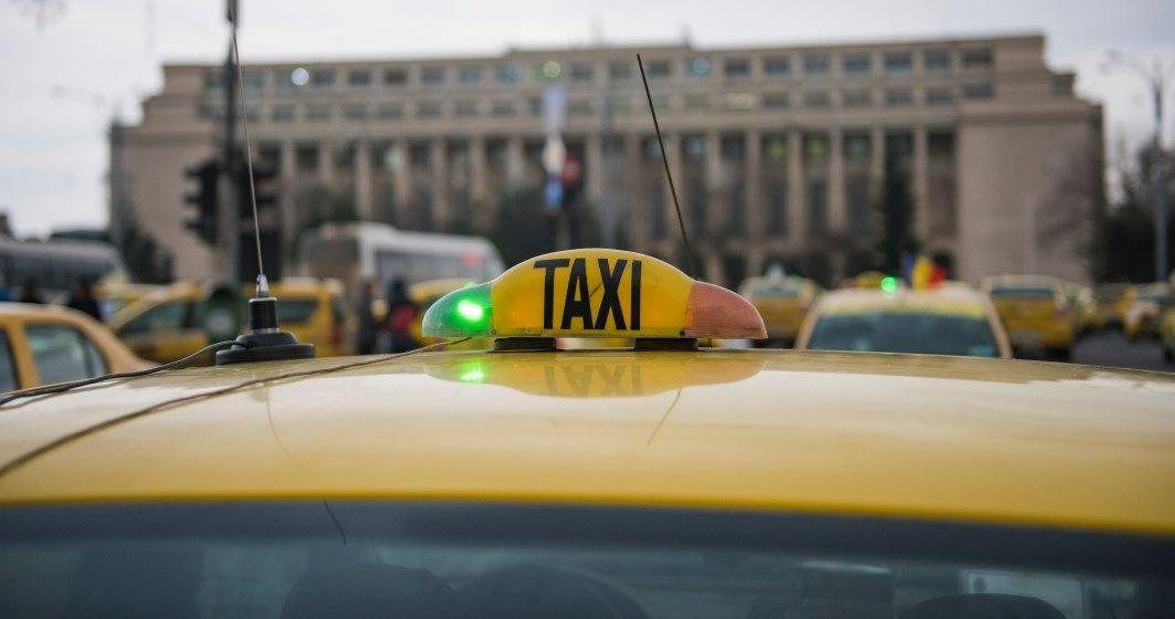 Transportatorii blocheaza Piata Victoriei si cer reglementarea aplicatiilor de tip car-sharing
