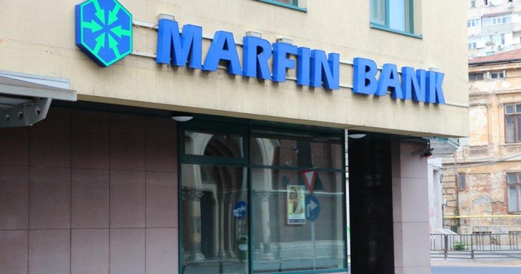 Marfin Bank a primit opt amenzi de 100.000 lei de la BNR