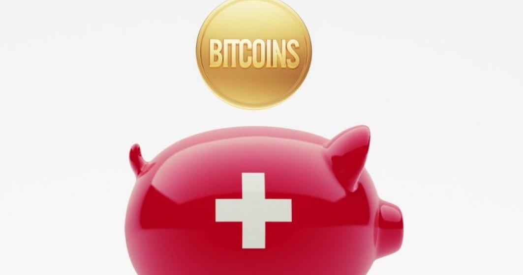In timp ce chinezii pun bete in roate monedei Bitcoin. Elvetienii se pregatesc sa isi plateasca taxele cu ea