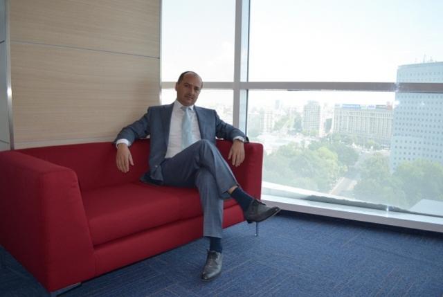 """Birou """"de austeritate"""". Cum arata noul sediu in care Borza a mutat Hidroelectrica - Foto 1 din 27"""